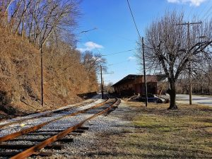 Top Baltimore suburbs to buy a house. A railroad, house, tree.